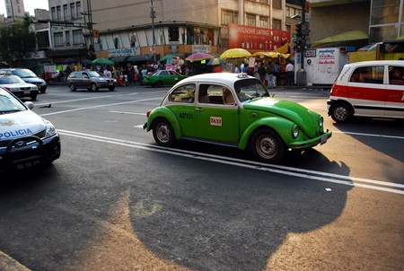 My father-in-law couldn't resist the lure of the vocho taxi and snapped this great shot.