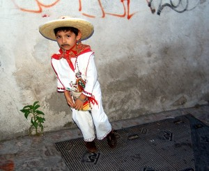A kid dressed up for Dia de Guadalupe.