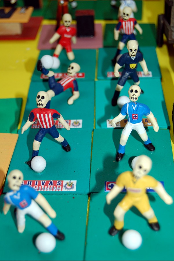 Little figurines of soccer players -- post-life.