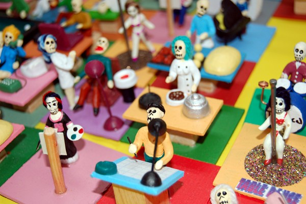Little figures of various professions are for sale. Including table dancers.