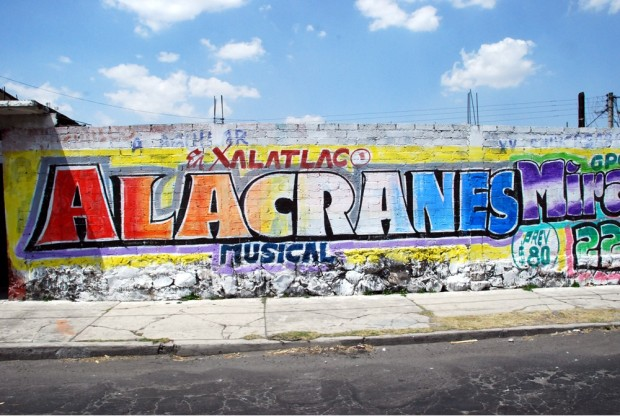 "An ad for a music group's performance - ""Alacranes"" means scorpions."